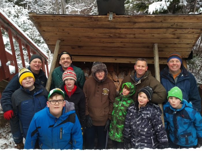 26th Halifax Cubs and Scouts filling wood box at cabin.